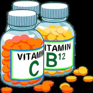 Drei Flaschen mit Vitamintabletten gefüllt